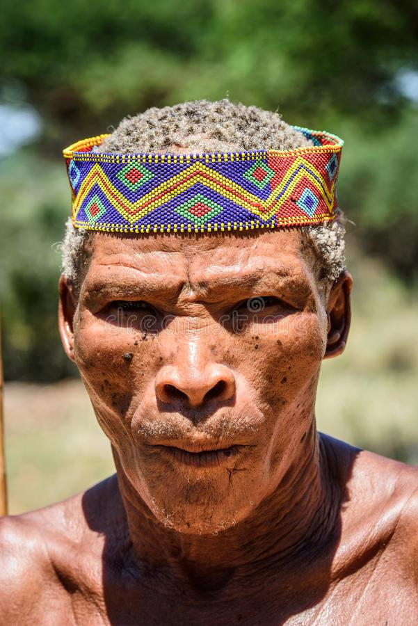 Bushman people in Namibia. EAST OF WINDHOEK, NAMIBIA - JAN 3, 2016: Unidentified bushman man portrait. Bushman people are members of various indigenous hunter stock photography