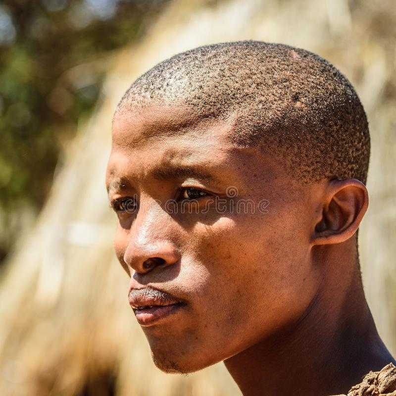 Bushman people in Namibia. EAST OF WINDHOEK, NAMIBIA - JAN 3, 2016: Unidentified bushman man portrait. Bushman people are members of various indigenous hunter royalty free stock photo