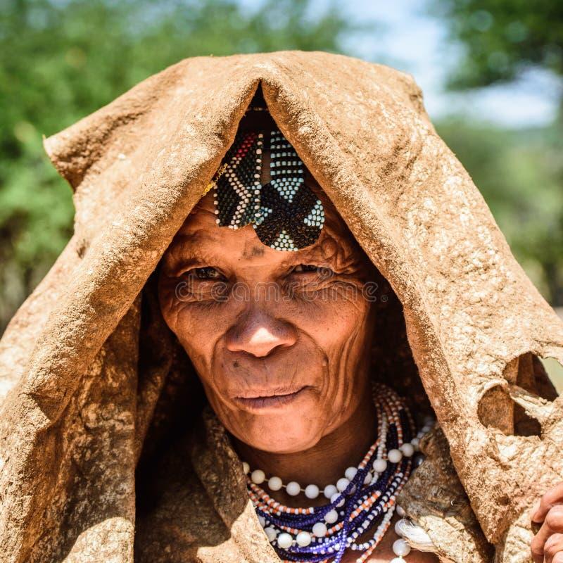 Bushman people in Namibia. EAST OF WINDHOEK, NAMIBIA - JAN 3, 2016: Unidentified bushman old lady. Bushman people are members of various indigenous hunter royalty free stock photos