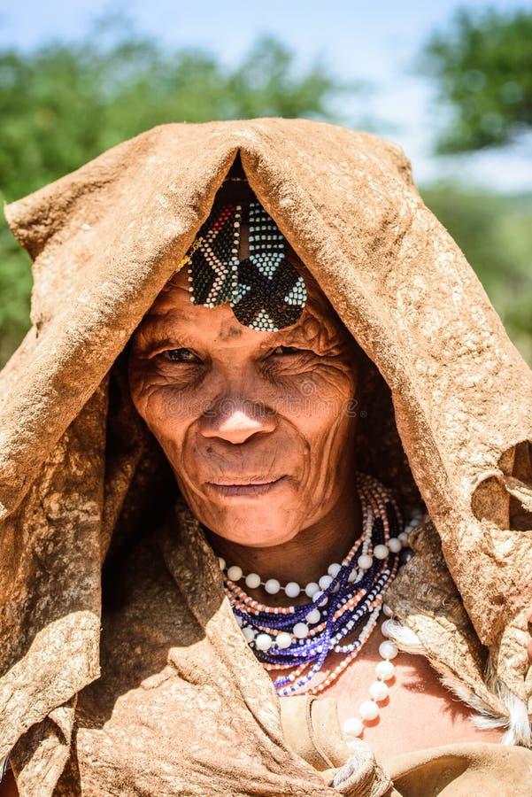 Bushman people in Namibia. EAST OF WINDHOEK, NAMIBIA - JAN 3, 2016: Unidentified bushman old lady. Bushman people are members of various indigenous hunter stock photo