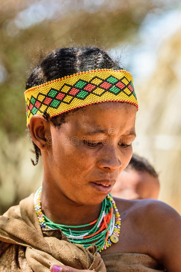 Bushman people in Namibia. EAST OF WINDHOEK, NAMIBIA - JAN 3, 2016: Unidentified bushman woman. Bushman people are members of various indigenous hunter-gatherer royalty free stock photography