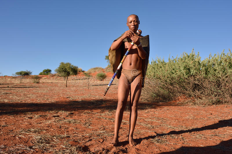 Bushmen hunter in the Kalahari desert, Namibia. KALAHARI, NAMIBIA - JAN 24, 2016: Bushmen hunter in the Kalahari desert. San people, also known as Bushmen are stock images