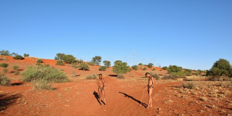 Bushmen hunters in the Kalahari desert, Namibia. KALAHARI, NAMIBIA - JAN 24, 2016: Bushmen hunters in the Kalahari desert. San people, also known as Bushmen are royalty free stock photos