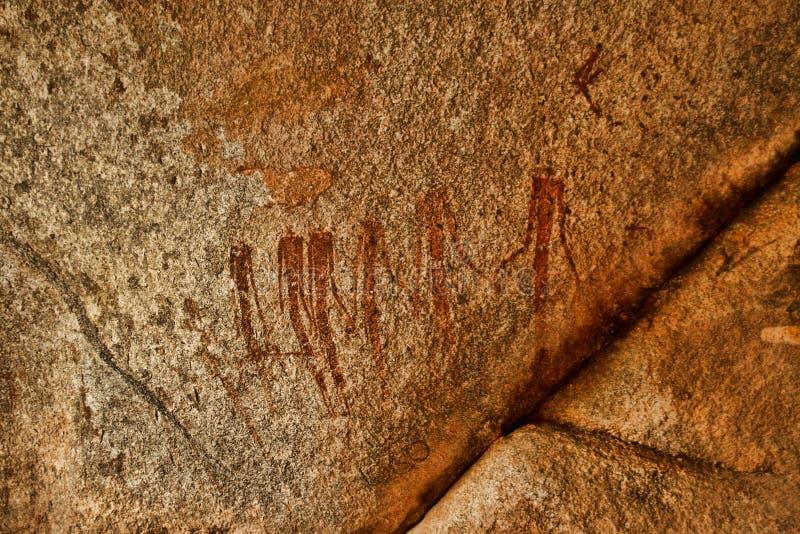 Bushmen rock painting of human figures and antelopes, giraffe of the Matopos National Park, Zimbabwe royalty free stock photo