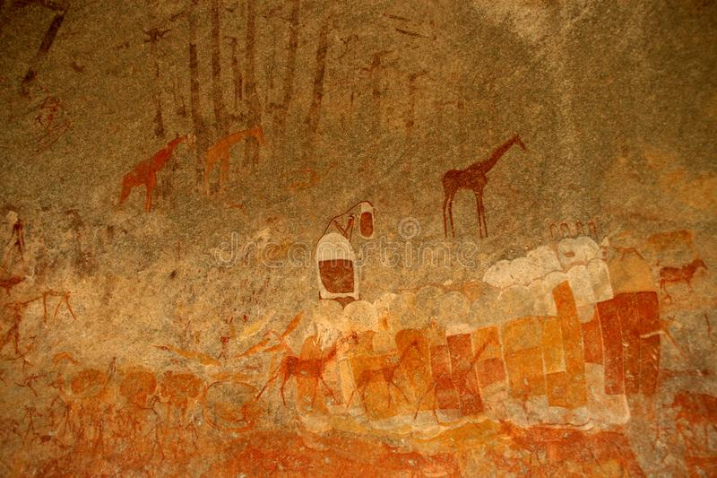 Bushmen rock painting of human figures and antelopes, giraffe of the Matopos National Park, Zimbabwe royalty free stock images