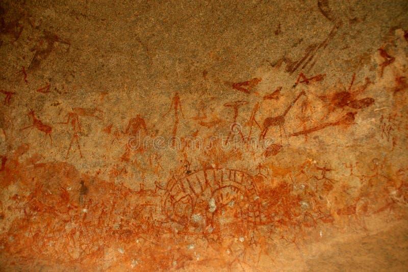 Bushmen rock painting of human figures and antelopes, giraffe of the Matopos National Park, Zimbabwe stock photos