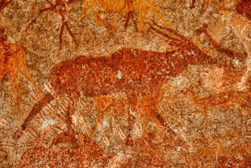 Bushmen rock painting of human figures and antelopes, giraffe of the Matopos National Park, Zimbabwe stock images
