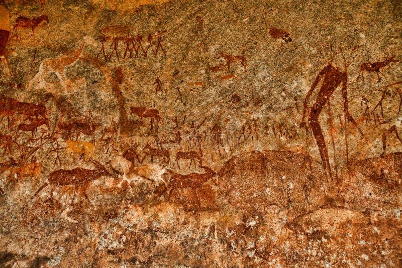 Bushmen rock painting of human figures and antelopes, giraffe of the Matopos National Park, Zimbabwe royalty free stock image