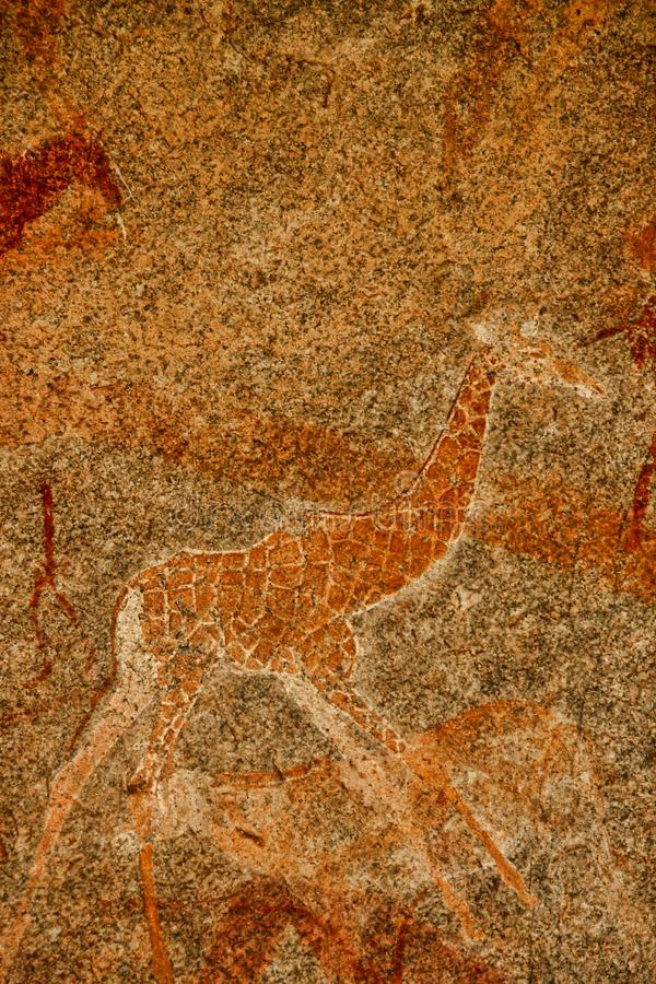 Bushmen rock painting of human figures and antelopes, giraffe of the Matopos National Park, Zimbabwe stock photography