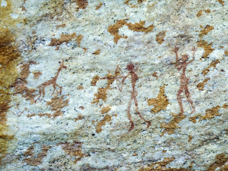 Bushmen san rock painting of humans and antelopes, Drakensber royalty free stock images