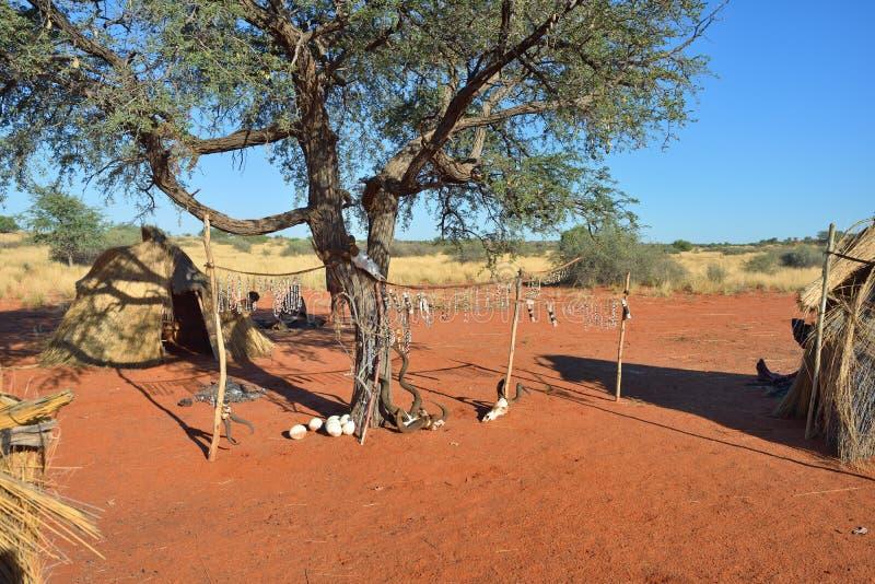 Bushmens village, Kalahari desert, Namibia. Bushmens village shown at morning time. The San people, also known as Bushmen are members of various indigenous stock image