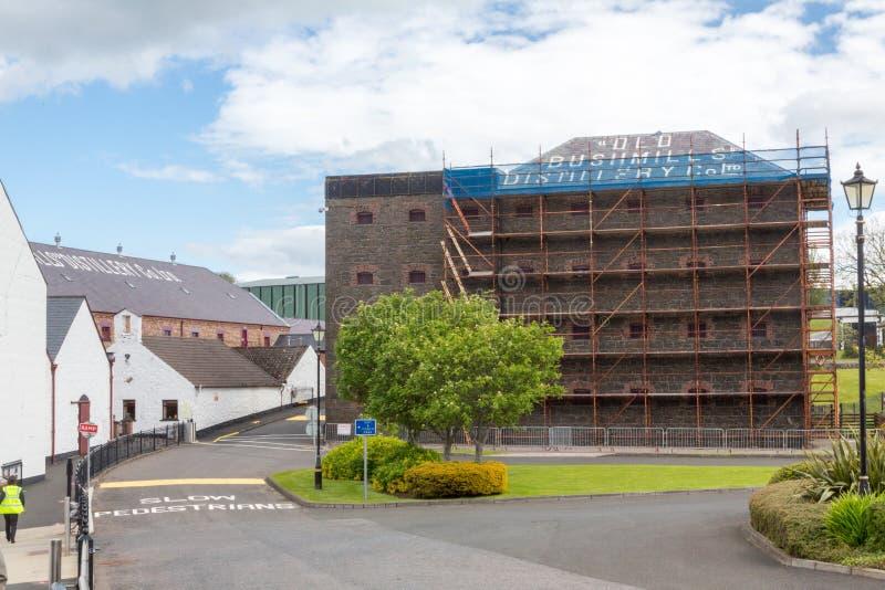 Bushmills Distillery under renovation. Bushmills, N. Ireland/United Kingdom - June 2, 2015: Bushmills Distillery, the oldest working distillery in the world on a stock images