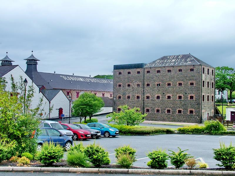 The Old Bushmills Whiskey Distillery. Bushmills, Northern Ireland - June 07, 2012: The Old Bushmills Whiskey Distillery, the oldest working distillery in Ireland stock images