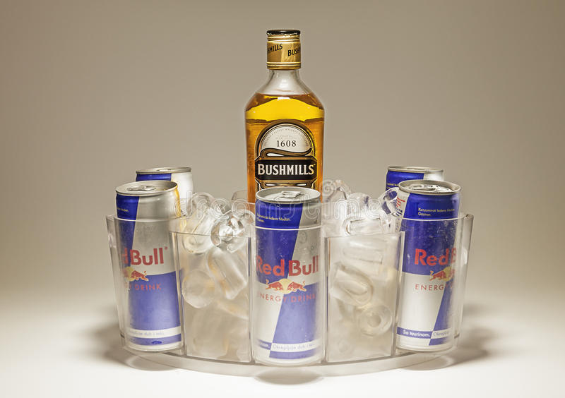 Bushmills and Red Bull. Cacak, Serbia - September 20, 2014: Bushmills and Red Bull cans served in special dish with ice royalty free stock images