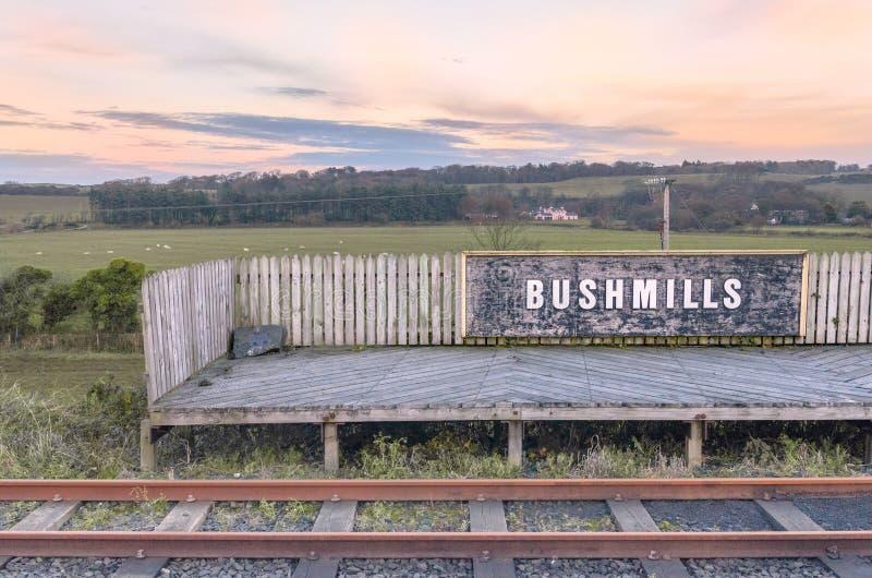 Bushmills Trains Station in Northern Ireland. Landscape at sunset of train station platform with fields behind in Bushmills, Northern Ireland royalty free stock photos