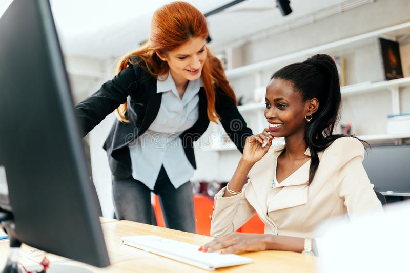 Busiensswoman advising colleague. In office during work royalty free stock photos