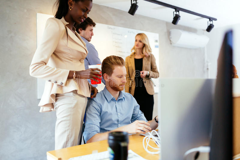 Busiensswoman advising colleague. In office during work stock photography