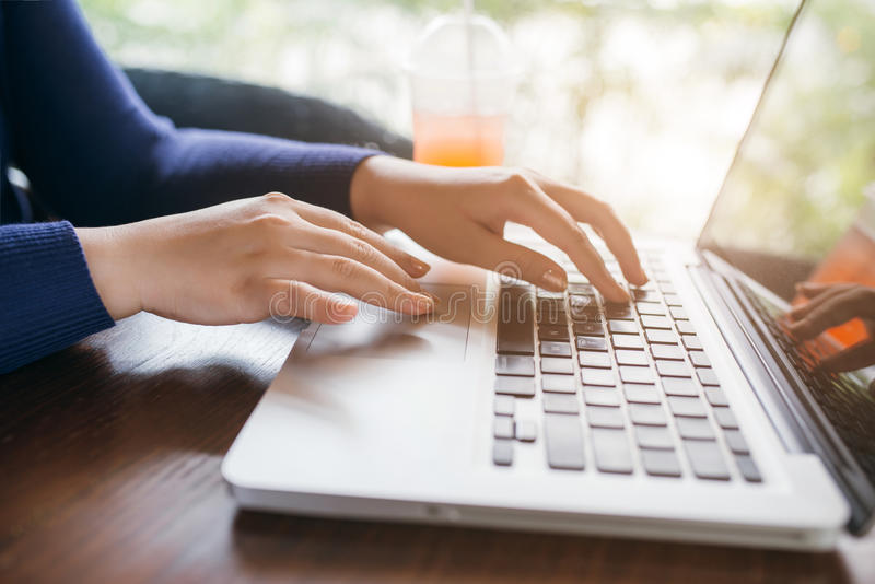 Busiensswoman hands pushing keys of computer, close up.  stock image