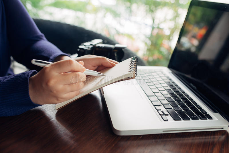 Busiensswoman hands pushing keys of computer, close up.  royalty free stock image