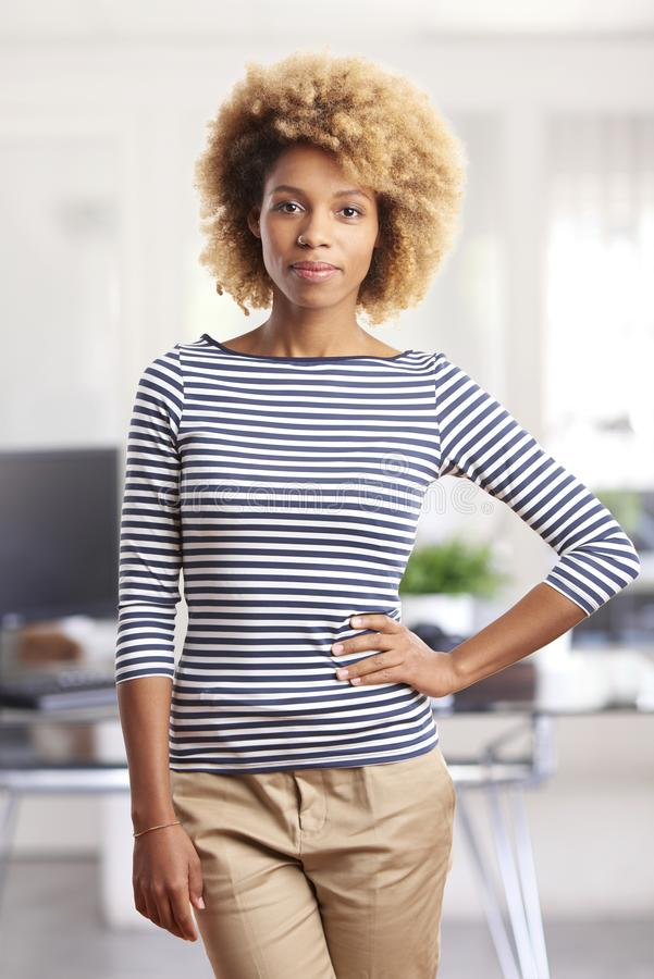 Busiensswoman in the office. A confident young afro-american marketing assistant businesswoman standing in the office stock photo