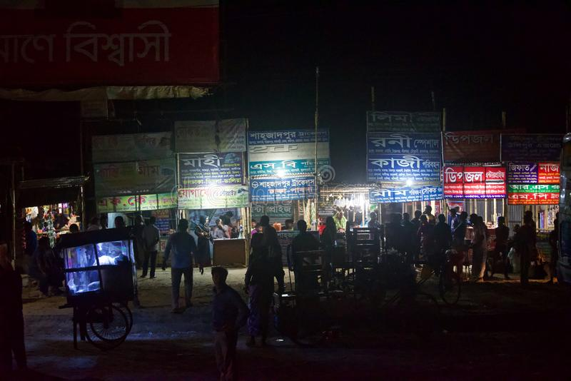 A busiest bus terminal around Dhaka city Bangladesh. Crowd of people waiting for their bus around a bus terminal at night in Bangladesh stock images