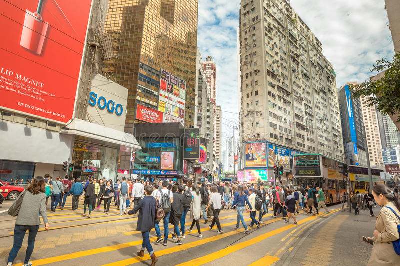 Busiest junctions in Hong Kong. Hong Kong, China - December 6, 2016: a vast crowd at Yee Wo Street junction with Hennessy Road, Causeway Bay, the luxury shopping stock photo