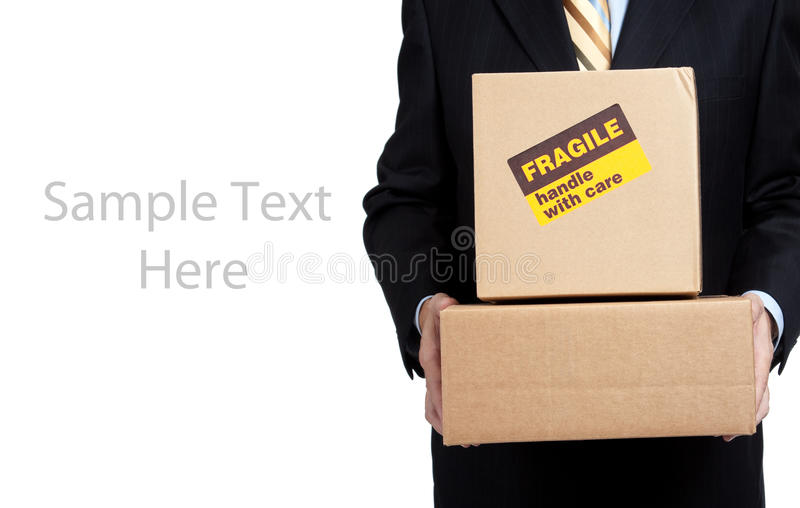 Busines man holding box with copy space