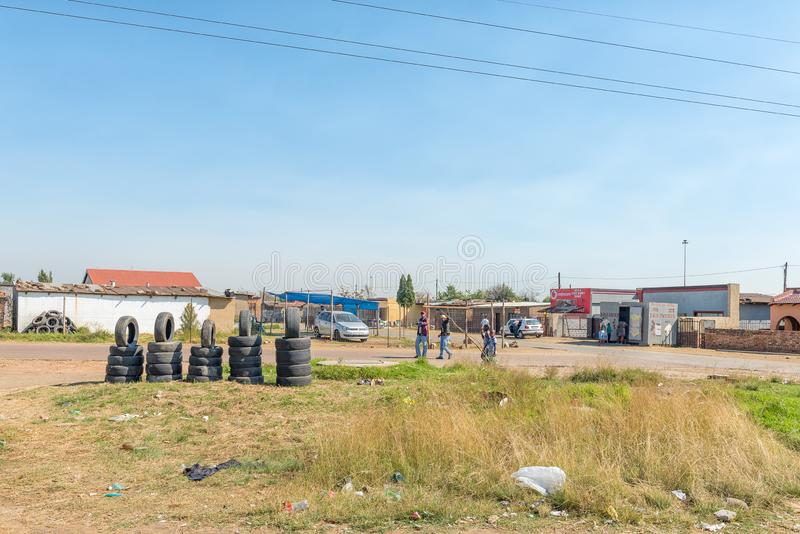 Busines, people and informal tyre shop, in the Emzinoni township royalty free stock image