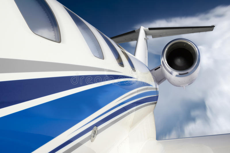 Businese Jet With Unique In Flight Perspective Through Clouds and Deep Blue Sky royalty free stock images