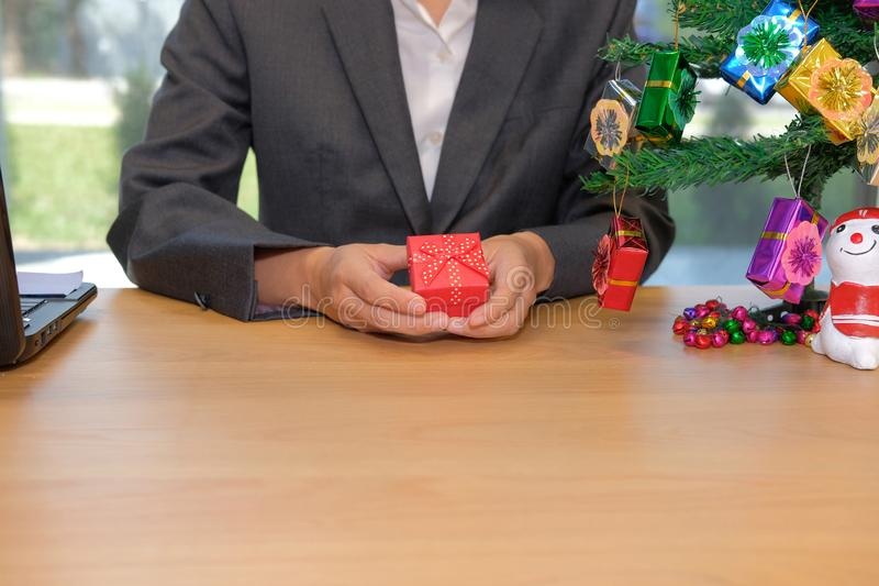 businesman holding christmas new year gift box at workplace stock image