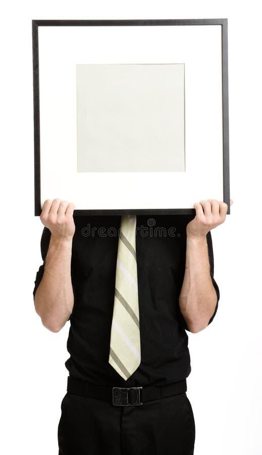 Businesman mit weißem Panel stockbild