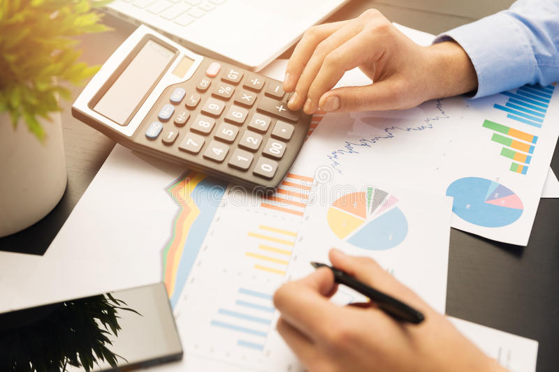 Businesman working on stock market graphs and charts stock photos