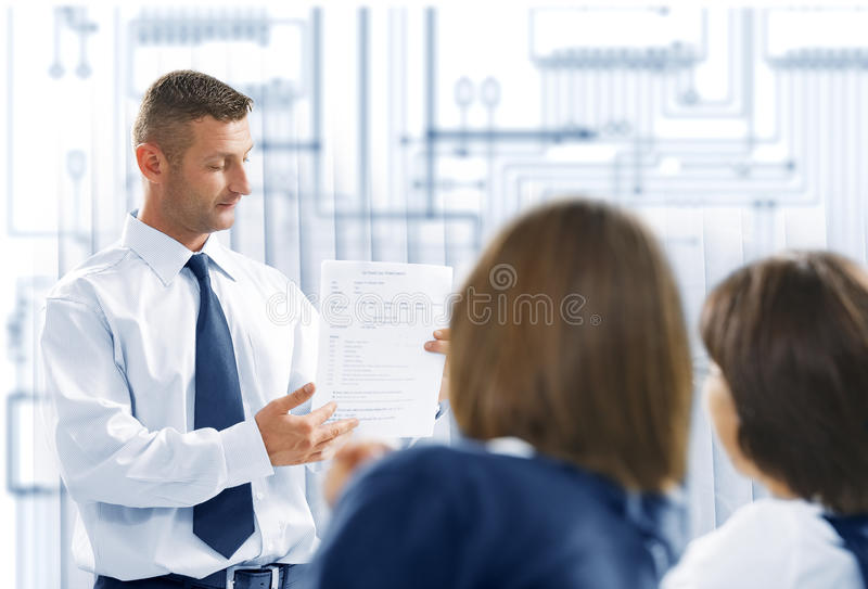 Business. Portrait of young business people discussing project in office environment stock photos