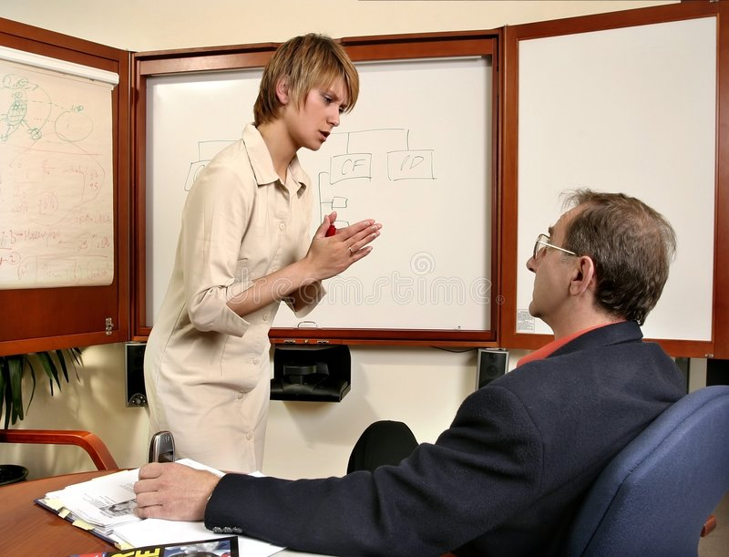 Business. Junior and Senior- failed presentation at work royalty free stock image