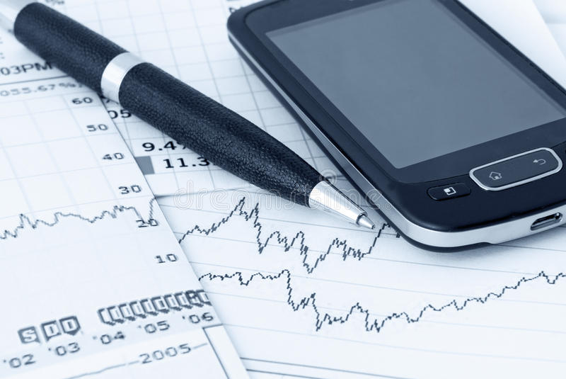 Business. Finance concept with chart, pen and cellular phone - in blue tone royalty free stock images