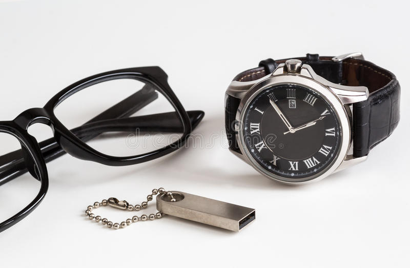 Business accessories. Glasses flash drive clock on a white background, business concept stock photography