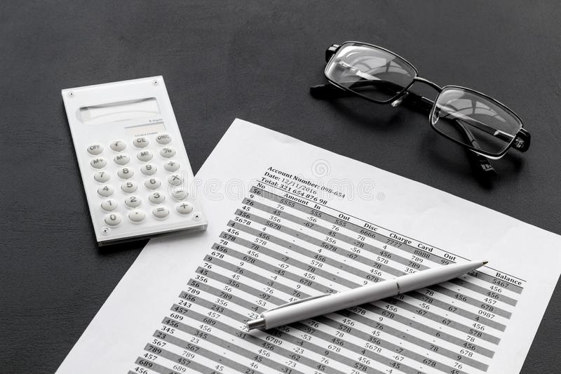 Business accounter work with taxes calculation and glasses on black office desk background stock photos