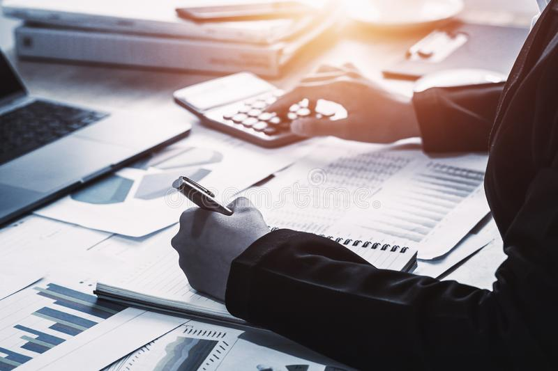 Business accounting finance concept. accountant using calculator for calculate  with laptop working in office. Investment, businessman, financial, analysis stock photos