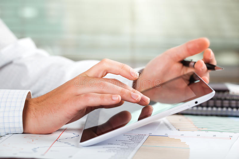 Business accounting. Male hand with things to do business in the office of the composition on the table stock photography