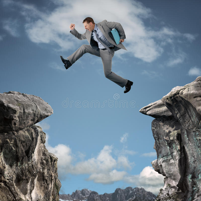 Business adversity. Businessman leap of faith concept for business adversity, risk or challenge royalty free stock photos