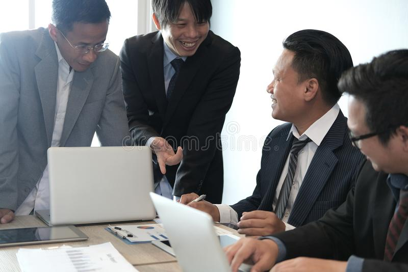 business adviser analyzing company financial report. professional investor discussing balance sheet statement. businessman stock image