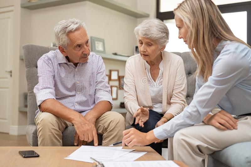 Senior couple discussing investment. Business agent planning with a retired couple their future investment opportunities. Financial advisor talking to elderly stock images
