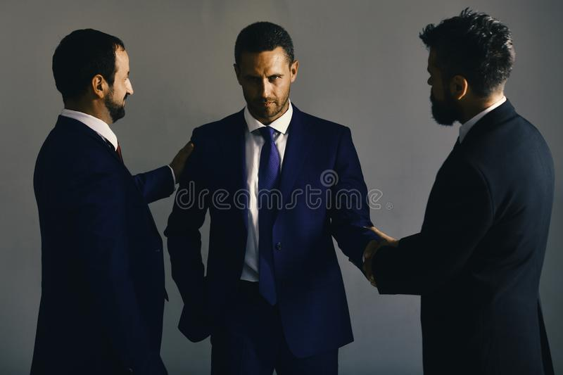 Business agreement and compromise concept. Businessmen wear smart suits. And ties. Men with beard and tricky faces negotiate making deal. CEOs settle disputes royalty free stock photography