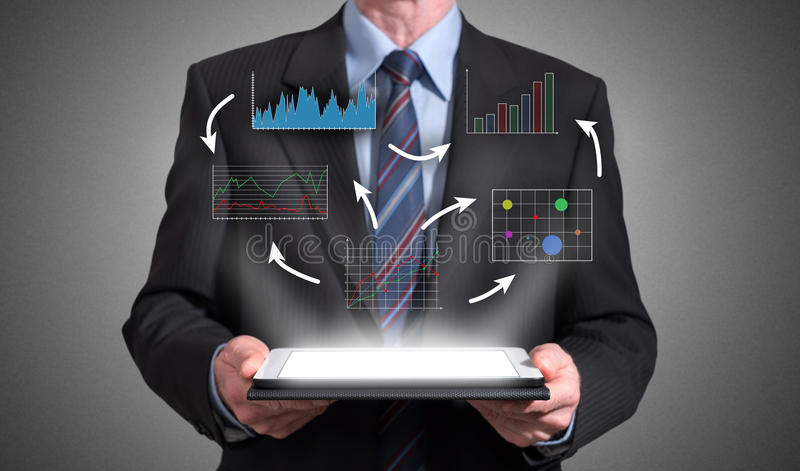 Business analysis concept appearing above a tablet royalty free stock image