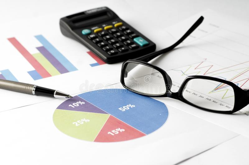 Business Analysis report with graph chart, glass and calculator for annual report stock photo