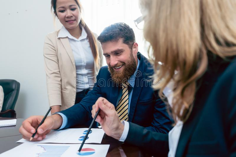 Business analyst smiling while interpreting financial reports sh royalty free stock image