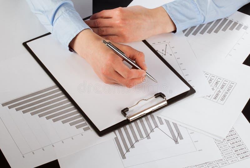 Business analyst working with data. Closeup shot stock photos