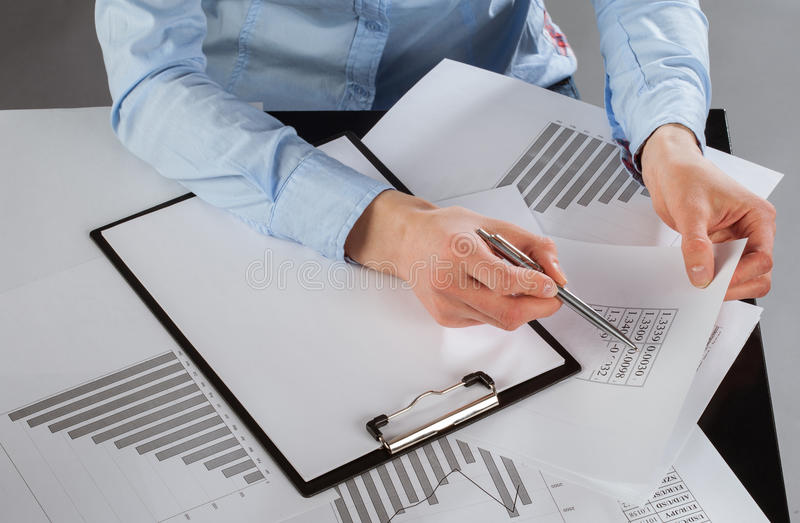 Business analyst working with data. Dark background royalty free stock image