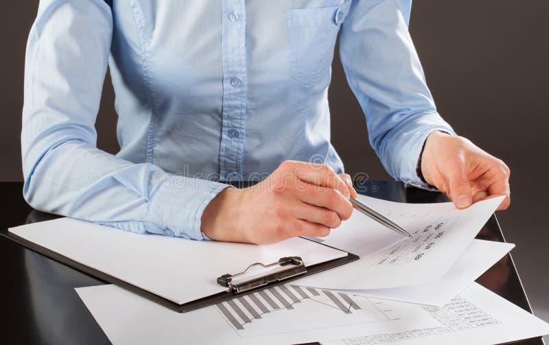 Business analyst working with data. Dark background stock photos
