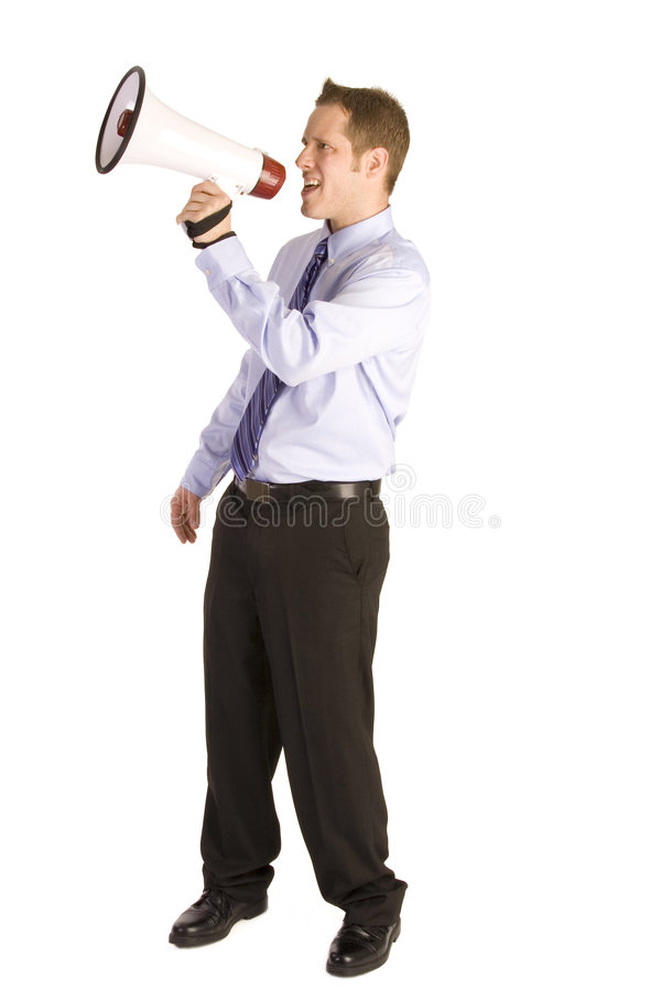 Business Announcement. Young businessman on white shouting into a megaphone stock photography